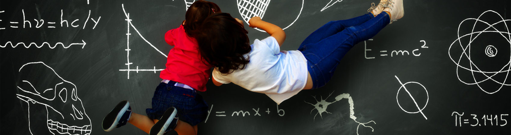 Two little writing girls on a blackboard with science subjects - Learning, knowledge and education concept